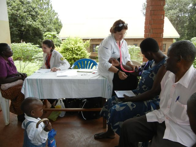 Stacy and Dr. Bohan take Blood Pressures at All Saints Cathedral, Church of Uganda