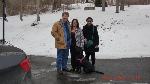 Vicky in the snow in Pennsylvania right before we left for the airport for the flight back to Uganda with Jeff, Karen, and Annie (dog) (note the green tennis ball that Annie is waiting patiently to have thrown for her!)