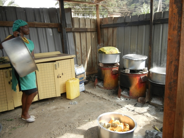 This is the cookhouse; the pot in the far corner is filled with matoke that is steaming in banana leaves