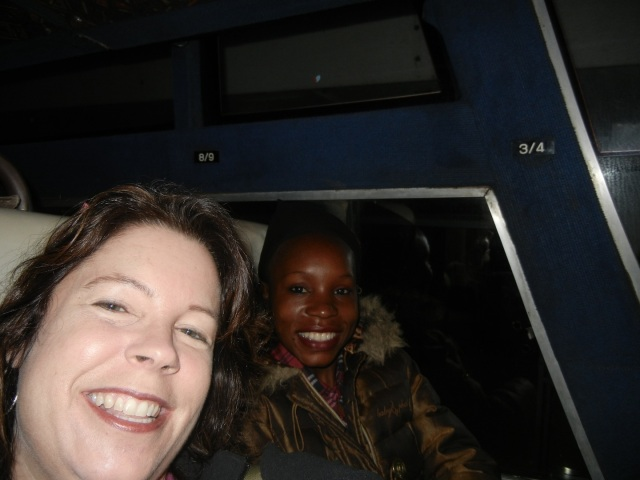 Waiting for the bus to take off on our road trip to Mbale- Barbara and KarenBeth