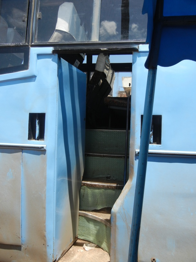 You enter through a small door in the side of the bus up a very steep flight of stairs- I had to hang on to the railing and pull myself up.