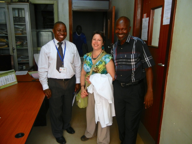 Benjamin, the Uganda Cancer Institute head pharmacist, KarenBeth, and Patrick
