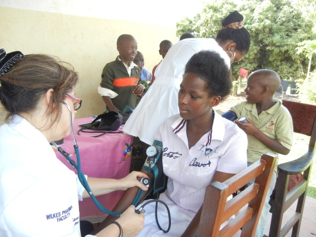 KarenBeth taking a patient's Blood Pressure
