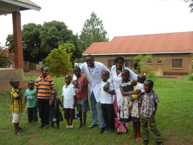 Sam and Linda play around with the kids who hung out all morning and avidly watched us- who know, maybe they are future pharmacists