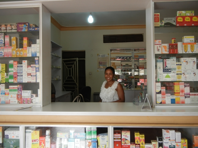 Vicky standing behind the dispensing counter