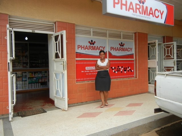 Vicky in front of her newly opened Community Pharmacy in Kampala