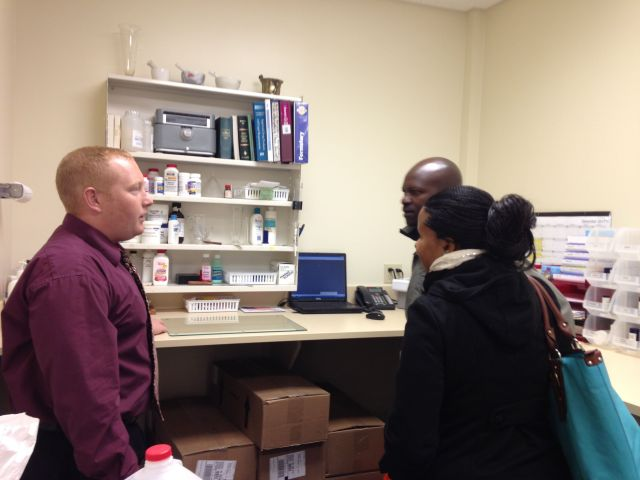 Rich explains some of the pharmacy procedures to Patrick and Vicky on Day 1 of their experience in USA