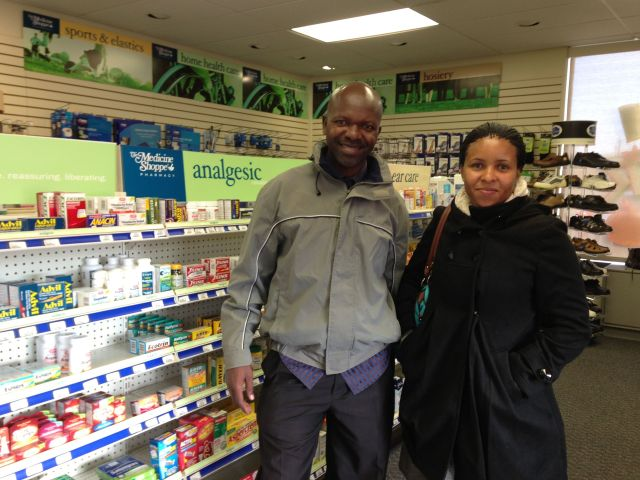 "Patrick and Vicky in the aisle of the Medicine Shoppe- Note the coats- besides the ""culture shock"" there was definitely ""cold shock""!"