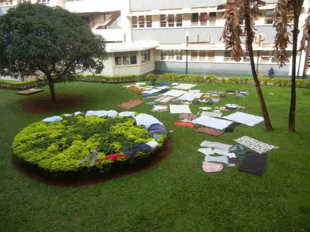 Caregivers of the patients spread laundry all over lawn at the hospital to dry