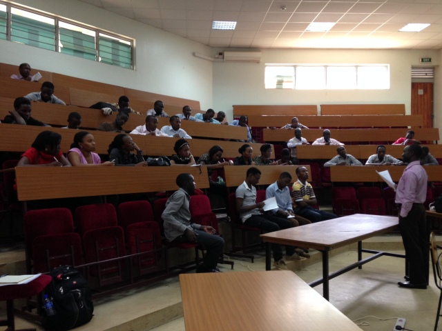 4th Year Pharmacy Students gather to find out what topics they have to study for this week's Problem-Based Learning (PBL) tutorial; Mr. Kalidi Rajab, BPharm, MPS is speaking