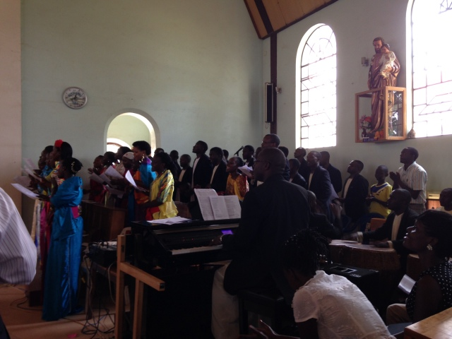 The Choir sings a lively hymn in their bright colored traditional garments