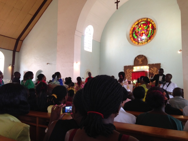 The St. Peter Choir of St. Augustine Church, Makerere University, processes towards the altar carrying gifts of Thanksgiving