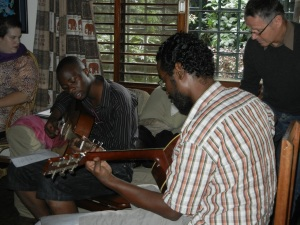 Musician's rehearsing prior to the home worship service
