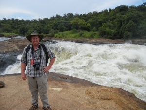 Jeff standing on a rock at the top of these Magnificent Falls