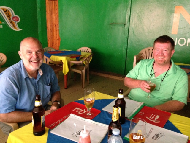 Monty (on left) and Jeff (on right) enjoying a  cold Ugandan brew after a 2 hour worship service at a delicious, and reasonably priced, Indian Restaurant on campus