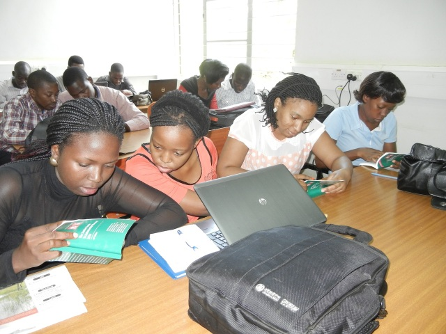 Using the recently donated Sanford's Guide to Antimicrobial Therapy, 4th Year Pharmacy students work on a class exercise