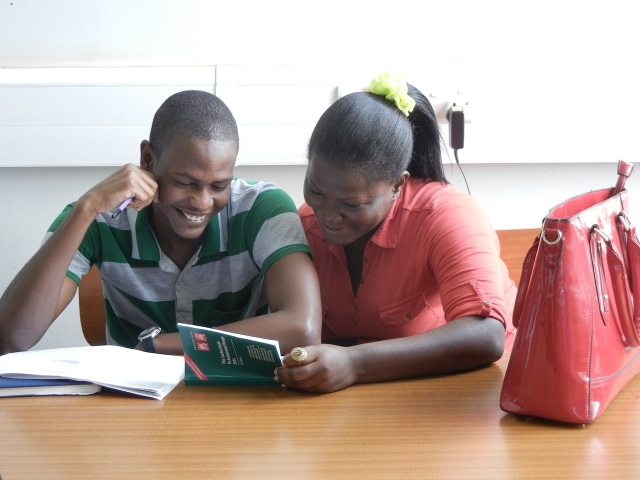 These are two 3rd year Pharmacy Students working together in class using the newly donated Sanford's Guides to Antimicrobial Therapy