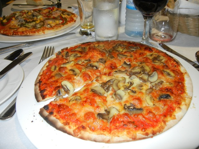 A Mushroom and Cheese Pizza- Yummy (called a Fungi Pizza here)