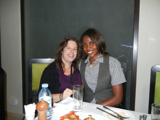 Cathy, one of the faculty at Makerere Pharmacy School, and me at the farewell dinner