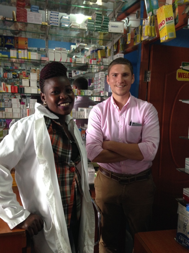 Inside Extra Care Pharmacy. Pictured are Gonsha, the Pharmacist and Owner and Joe, American Volunteer Pharmacist
