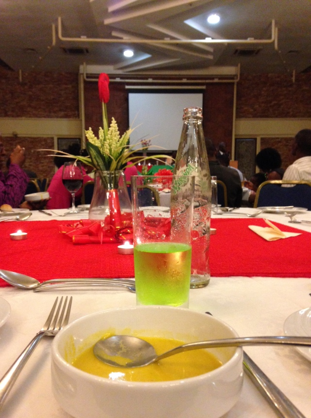 Dinner began with a bowl of delicious pumpkin soup; the green drink is a soda called Mirinda and it tastes kind of like Jolly Ranchers (an American hard candy); the decorations were lovely!