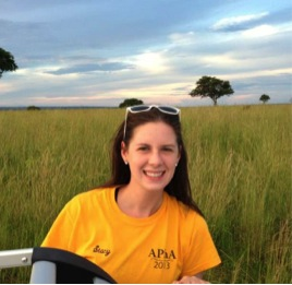Stacy with the Savannah dry lands of Murchison Falls National Park, Uganda in the background.
