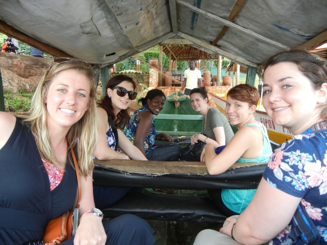 Heading off on our ride in a little covered wooden boat. (Left to right and front to back: Hanna, Lizzie, Kristen, Amanda, Brenda (our guide, Arthur's friend), and Stacy)