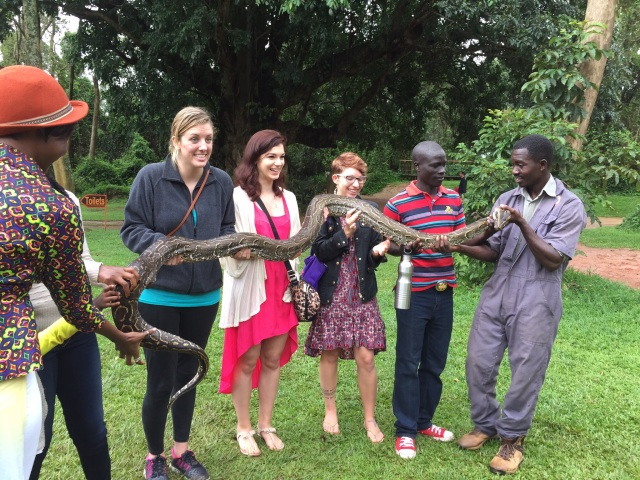 "Hanna, Kristen, and Amanda help to hold an African Rock Python- they said it was ""squishy"""