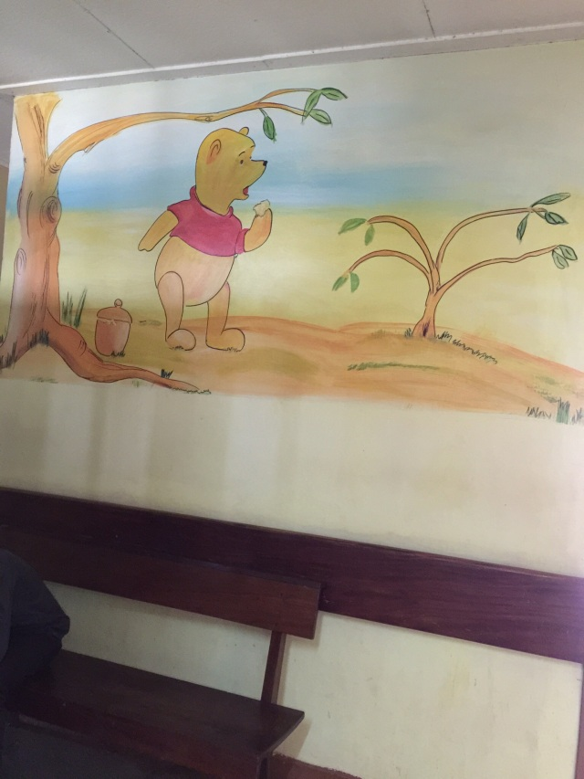 The walls of the pediatrics ward are covered in brightly colored paintings of Disney characters.