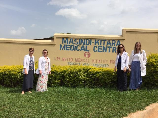 Amanda, Lizzie, Kristen and Hanna outside the entrance to Masindi-Kitara Medical Center, Masindi, Uganda