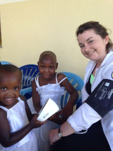Lizzie had fun playing with the children too! She not only had her BP taken but also had her hair braided.