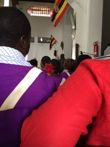 We sat behind the choir and you can just barely see the Arch Bishop preaching with his red stole.
