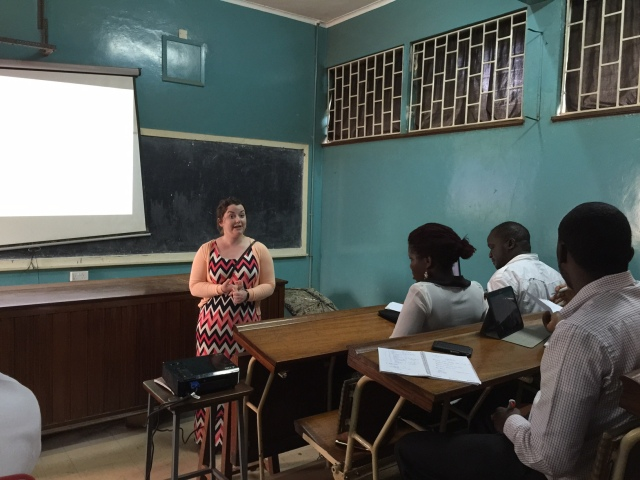 Lizzie presenting her patient case on Sepsis to the group of Pharmacy Interns at Mulago Hospital