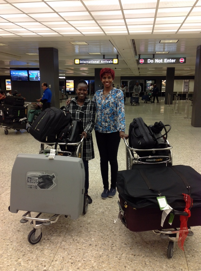 Two happy Ugandans have safely arrived and passed U.S. Customs at Washington-Dulles Airport in Virginia.