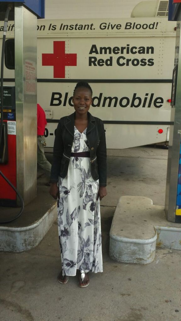 At a Gas Station, Gonsha was impressed by the large American Red Cross bus fueling up opposite my car. She asked the driver if she could take a picture and it made me smile because that is what I do all the time in Uganda. She also found the automatic, self-pay fueling machines fascinating.