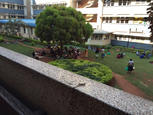 This is an image of the courtyard in one part of the extremely large Mulago Hospital. You can see how the caregivers gather here to dry laundry and cook food.