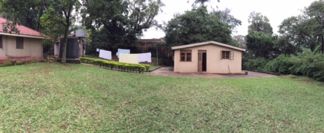The small house to the right of the photo is my home away from home in Kampala.