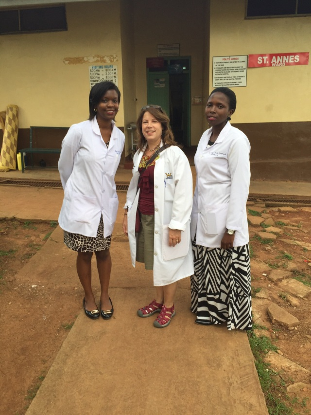 Edel, KarenBeth, and Linda- some of my past Ugandan Students. We are standing outside of the women's ward.
