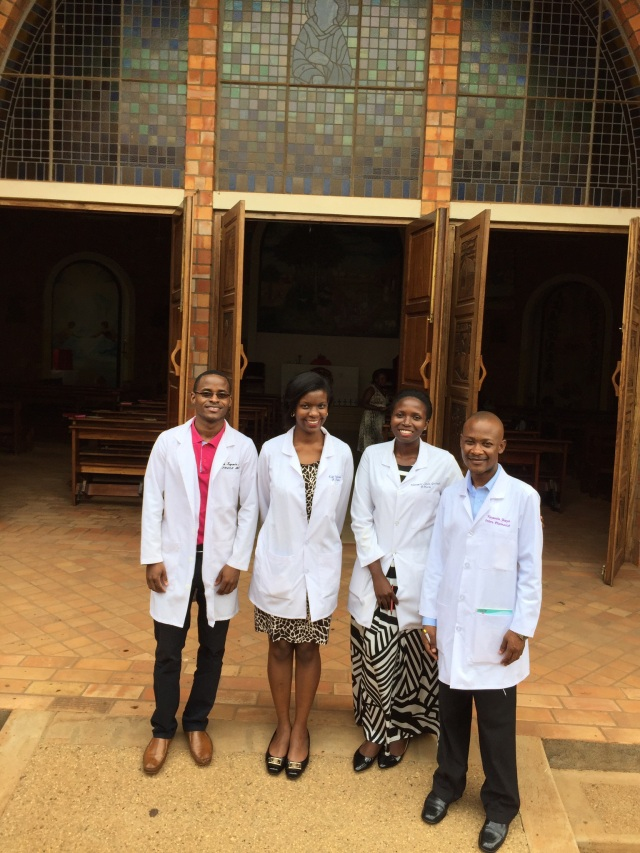 Aaron, Edel, Linda, and Joseph stand outside the beautiful Catholic Chapel on the Campus of Nsambya