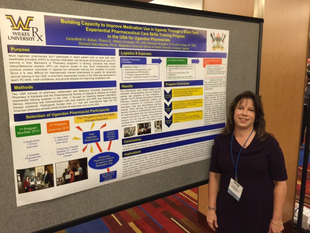 Presenting the Poster on the Pharmaceutical Care Training Program for Ugandans in the USA