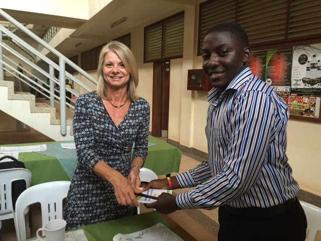"Simon, the MUPSA President and the leader of the 4th Year class welcomes Susan Raber back to Uganda to teach. I love the notepad they gave her. I use them all the time while here- they are the perfect ""pocket"" size- not too big but not too small"