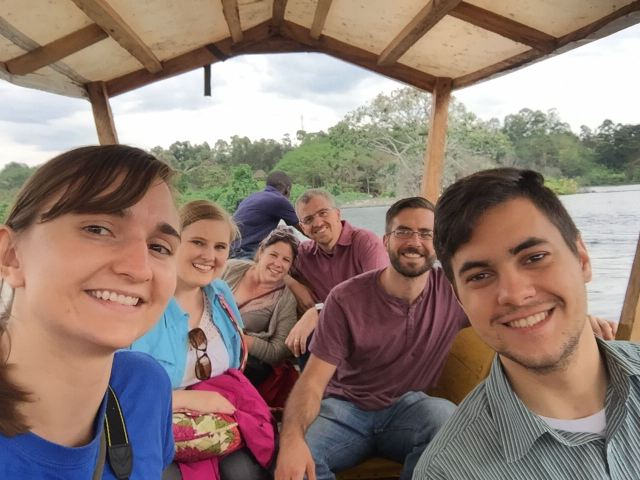 A group selfie on the wooden boat that took us to the Source of the Nile River