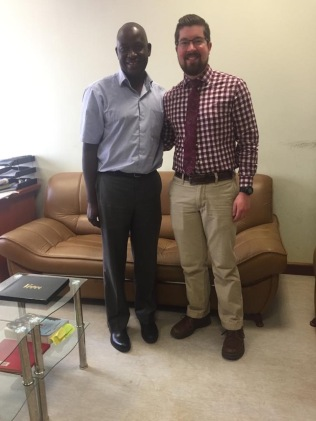 Dr. Kamba, Head of the Pharmacy School, with Christian